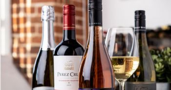 Bottles and glasses of wine from Virgin Wines